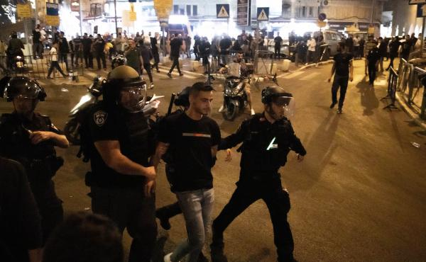 Israeli police take a Palestinian into custody during a protest at the Masjid al-Aqsa compound in East Jerusalem on Sunday.