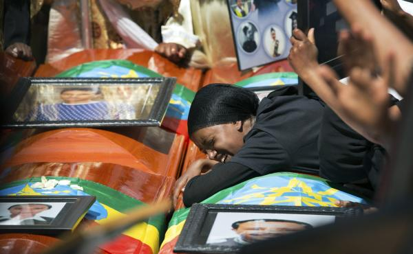 Mourners grieve next to empty caskets at a mass funeral at Holy Trinity Cathedral in Addis Ababa, Ethiopia, on Sunday.