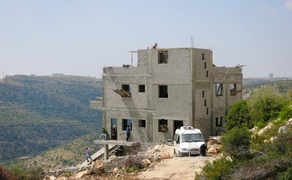 One of the first homes going up on land bought and sold as part of a Canadian-Palestinian investment firm's effort to properly register plots. Much land in the West Bank is not registered and has no title deed, creating problems for economic development.