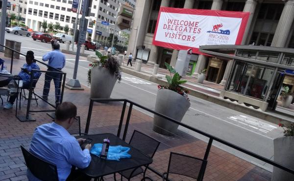 A sign welcomes visitors in downtown Cleveland days before the city hosts the Republican National Convention.
