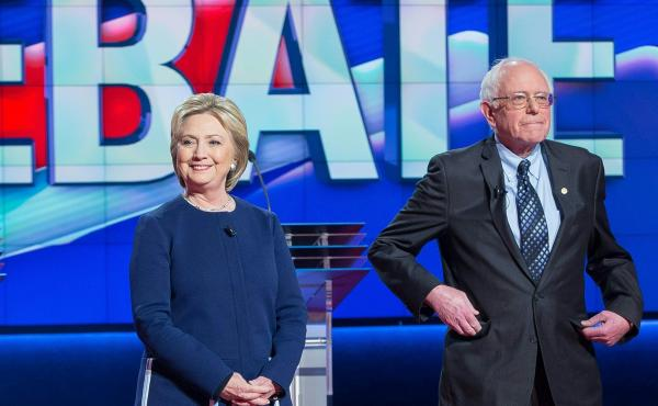 Democratic presidential candidates Hillary Clinton and Bernie Sanders await the start of the Democratic Debate in Flint, Michigan, March 6, 2016.