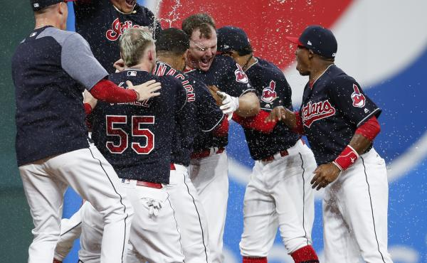 Jay Bruce of the Cleveland Indians celebrates with teammates after hitting a game-winning double off Brandon Maurer of the Kansas City Royals during the 10th inning Thursday at Progressive Field in Cleveland.