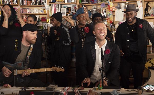 Coldplay performs a Tiny Desk Concert at NPR Music on Jan. 23, 2019 (Emily Bogle/NPR)