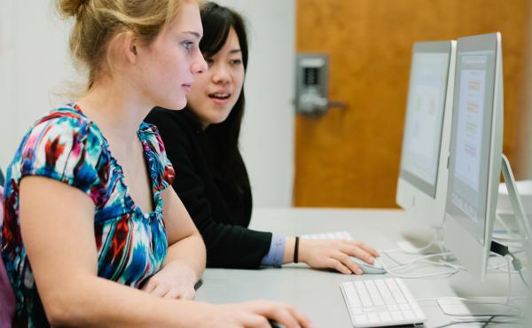 Harvey Mudd College students Ellen Seidel and Christine Chen work on a summer research project in computer science.