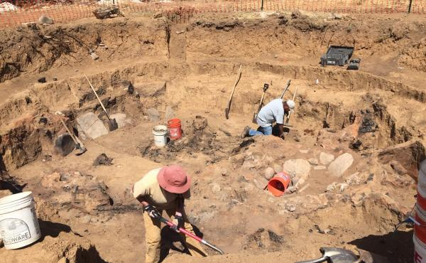 Archaeologists excavate one of the Ancestral Puebloan pit houses in the path of the planned highway in southern Colorado.