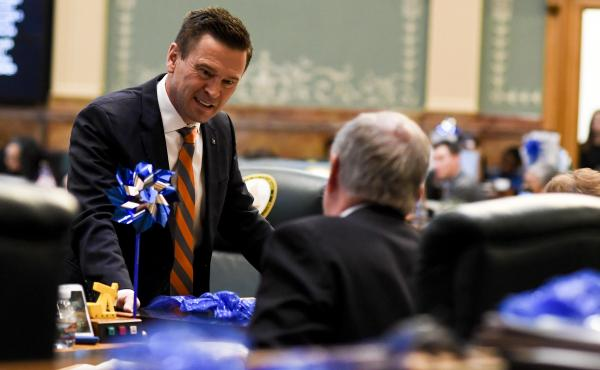 Colorado State Rep. Cole Wist speaks to State Rep. Larry Liston at the Colorado State Capitol on April 25, 2018. Wist, a Republican, is one of the sponsors of a bill that would allow guns to be temporarily taken away from someone who is a significant risk