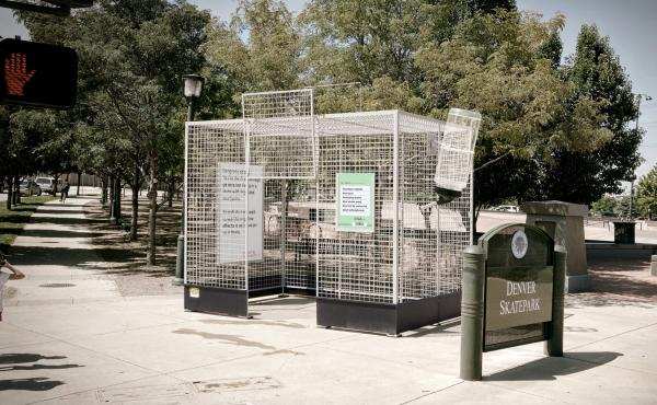 This human-scale lab rat cage is  parked near a skate park in Denver, Colo., to make a point about the lack of science on marijuana.