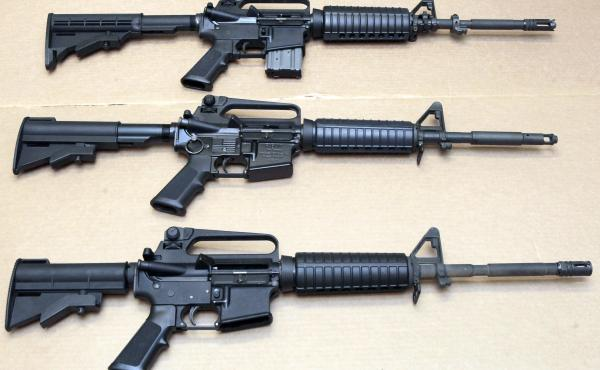 Three variations of the AR-15 rifle are displayed at the California Department of Justice in Sacramento, Calif., in a 2012 photo. On Thursday, Connecticut-based Colt's Manufacturing Co. said it was suspending production of its version of the AR-15 for the