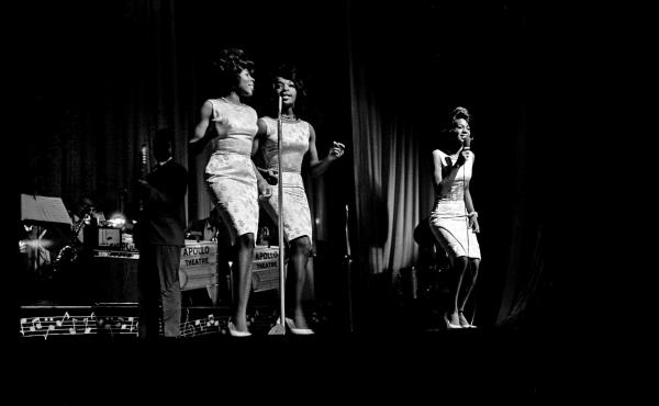 From left: Betty Kelly, Rosalind Ashford and Martha Reeves of Martha and the Vandellas perform circa mid-1964 at the Apollo Theater in Harlem, New York.