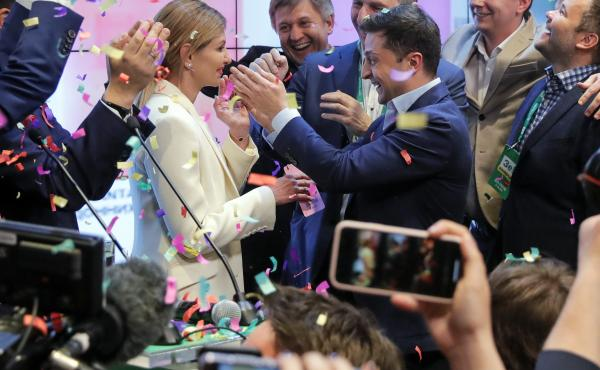 Ukrainian comedian and president-elect Volodymyr Zelenskiy, center right, and his wife Olena Zelenska, center left, greet supporters at his headquarters on Sunday.