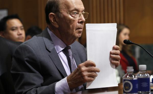 Commerce Secretary Wilbur Ross, who oversees the Census Bureau, straightens his papers during a 2018 Senate hearing in Washington, D.C. Ross is testifying before the House Oversight and Reform Committee about the census on Thursday.