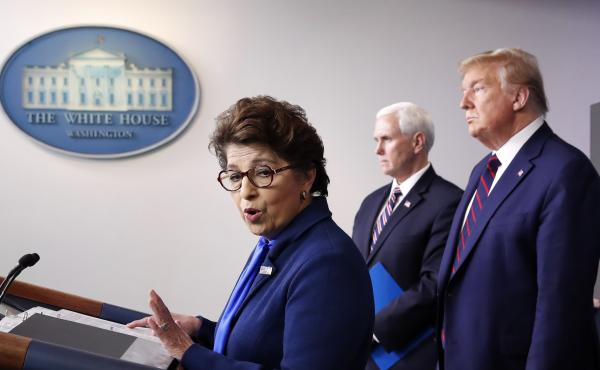 Jovita Carranza, administrator of the Small Business Administration, speaks in the James Brady Press Briefing Room of the White House, as Vice President Mike Pence and President Donald Trump listen on April 2, 2020.