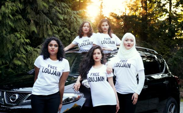 "Friends of Loujain al-Hathloul made a photo to parody a Vogue Arabia cover image showing a Saudi princess in a red convertible. Pictured here (left to right) are Ayendri Ishani Ridell, Urooba Jamal, Narissa Diwan, Atiya Jaffar and Rauza Khan. Hathloul ""to"