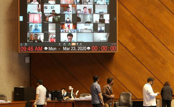 A huge video screen shows members of the Philippine Congress participating in a special session via video conference in Manila on Monday to discuss a proposed emergency power to be given to President Rodrigo Duterte to tackle the COVID-19 coronavirus outb
