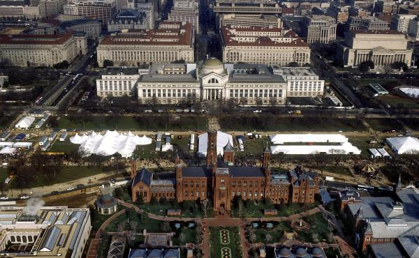 """An aerial view of the National Mall in Washington, D.C., with the Smithsonian Institution Building (""""The Castle"""") in the foreground and the Smithsonian's National Museum of Natural History in the background."""