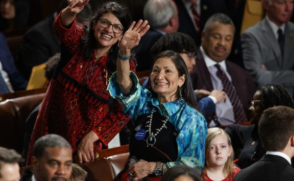 Rep. Rashida Tlaib (left) and Rep. Deb Haaland look up to the gallery at the U.S. Capitol on Thursday, their first day as members of Congress.