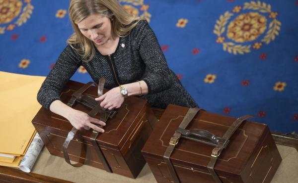 Connecticut is the latest state to pledge its electoral votes based on the outcome of the national popular vote. Here, an aide opens Electoral College ballot boxes during a joint session of Congress in January of 2017, to tally ballots for the president a