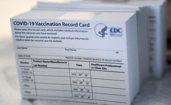 A stack of COVID-19 vaccination record cards from the Centers for Disease Control and Prevention. They provide proof that you've had your shot — but aren't exactly wallet size at 4 by 3 inches.