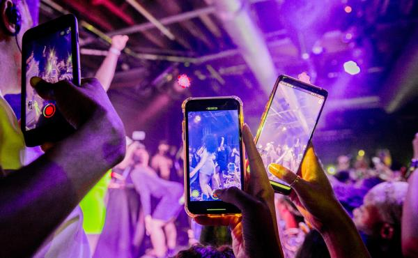 You can do a lot of things with minimal risk after being vaccinated. Although our public health expert says that maybe it's not quite time for a rave or other tightly packed events. Above: Fans take photographs of Megan Thee Stallion at a London show in 2