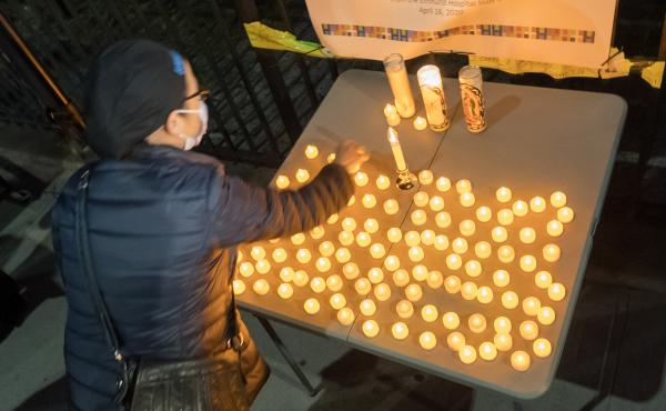The U.S. death toll from COVID-19 hit a new milestone, surpassing the number of Americans who died in the prolonged conflict with Vietnam. Here, the Elmhurst Hospital Center in Queens, N.Y., holds a vigil for medical workers and patients who have died in