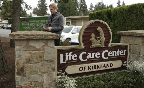 Tim Killian, a spokesman for Life Care Center in Kirkland, Wash., prepares to give a daily briefing to reporters on Wednesday.
