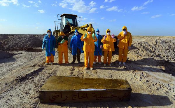 On April 3, Iraqi volunteers in full hazmat gear prayed over the coffin of a 50-year-old who died of COVID-19. She was buried at a cemetery specifically opened for such deaths, some 12 miles from the holy city of Najaf.