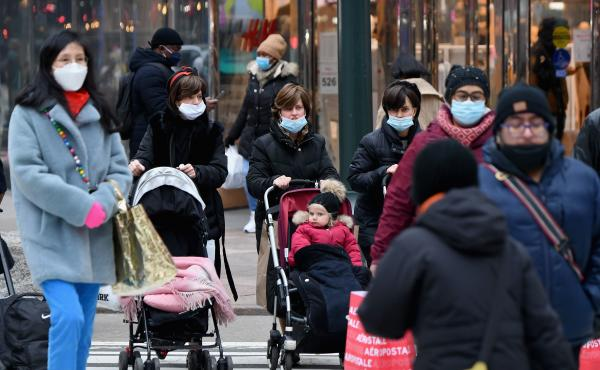 People walk through a busy shopping area amid the coronavirus pandemic on Jan. 5 in New York City. Coronavirus cases are up in almost every state.
