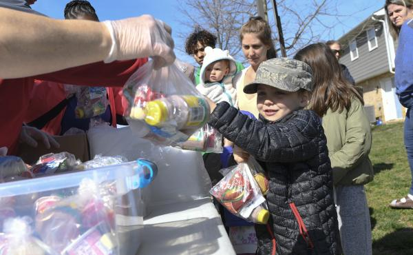"""Kids whose schools are shut down in Anne Arundel County, Md., receive food in Annapolis as part of a program to ease the burden of feeding students while schools are closed because of the coronavirus. President Trump told Americans to """"engage in schooling"""