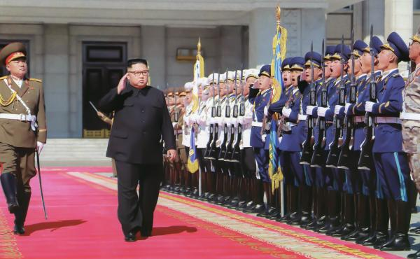Kim Jong Un inspects troops ahead of North Korea's 70th anniversary parade in Pyongyang in 2018. At least one foreign policy expert warns that U.S. adversaries could take advantage of the uncertainty stemming from President Trump's positive coronavirus te