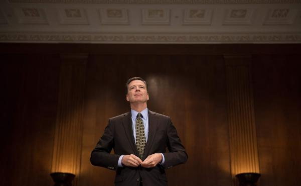 Then-FBI Director James Comey prepares to testify before the Senate Judiciary Committee on Capitol Hill on May 3.
