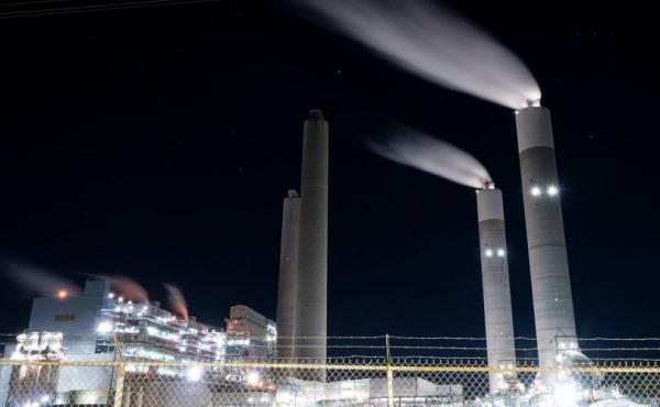 Meeting the goals of the Paris Agreement will require completely eliminating carbon dioxide emissions from coal-burning power plants like this one in Adamsville, Alabama