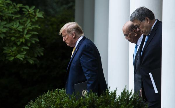 President Trump, Commerce Secretary Wilbur Ross (center) and Attorney General William Barr walk into the White House Rose Garden for a July 2019 press conference on the census.