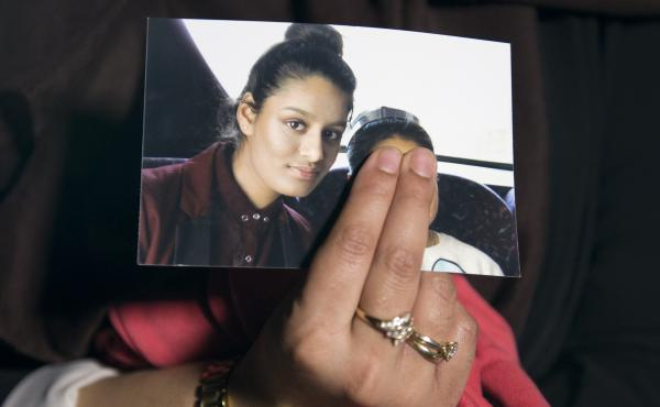 The eldest sister of Shamima Begum holds her sister's photo in 2015. Begum, who left London to join the Islamic State organization as a teenager, is now trying to return to the U.K. to argue that her British citizenship should not have been revoked.