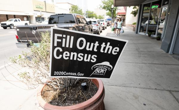 A sign promoting the 2020 census stands in a planter in Roswell, N.M., in August. A federal judge has ordered the Trump administration to continue holding off on wrapping up the census for now.