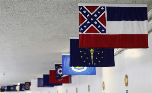 The state flag of Mississippi, which incorporates the Confederate battle flag in the top left corner, is displayed with the flags of the other  states and territories in the tunnel connecting the Senate office building and the U.S. Capitol in 2015.