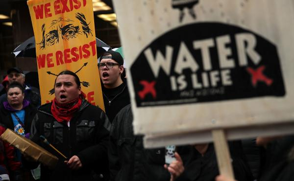 Members of the Standing Rock Sioux Tribe and its supporters, shown here during a demonstration in 2017, have opposed the Dakota Access Pipeline for years.