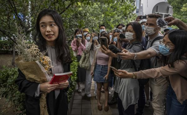 Zhou Xiaoxuan speaks to journalists and supporters on Sept. 14 outside the Haidian District People's Court in Beijing before a hearing in her case. She alleged that she was groped and forcibly kissed by prominent TV anchor Zhu Jun, who denies the allegati