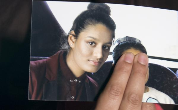 Renu Begum, eldest sister of Shamima Begum, holds her sister's photo as she is interviewed by the media at New Scotland Yard. The U.K. revoked Shamima Begum's British citizenship two years ago, citing security concerns.
