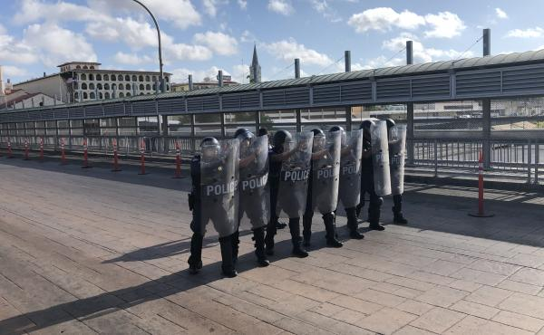A special response team with Customs and Border Protection drills on the international bridge between Laredo, Texas, and Nuevo Laredo, Mexico, in the event that desperate migrants rush the port of entry.