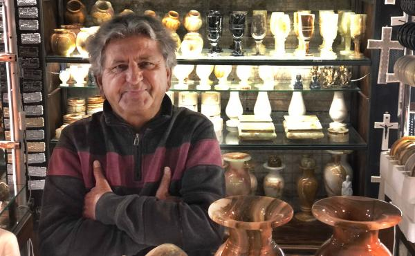 Yusuf Khan at his souvenir stand in the catacombs below Diocletian's Palace, built in the 4th century for the Roman Emperor Diocletian. It later became part of the city of Split. Khan, who has owned his stand for 20 years, typically earns $500 a day, but