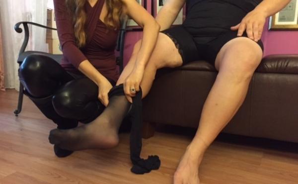 Miss Julia slipping stockings on Bianca.
