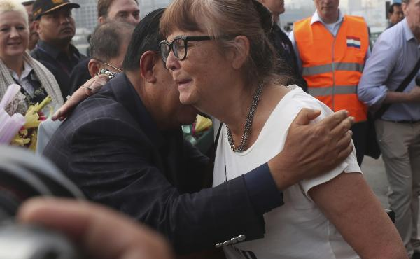 A passenger (right) is hugged by Cambodia Prime Minister Hun Sen after she disembarked from the MS Westerdam at the port of Sihanoukville, Cambodia, on Friday.