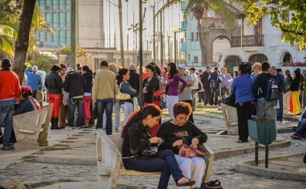 In this 2013 photo, Cubans line up in front of the U.S. Interests Section in Havana to try to get visas to travel to the U.S.