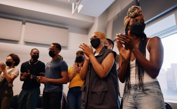 The cast of Hadestown gathered, masked, for their first rehearsal in 17 months. Broadway has strict safety protocols but there has been at least one breakthrough infection in a touring cast.