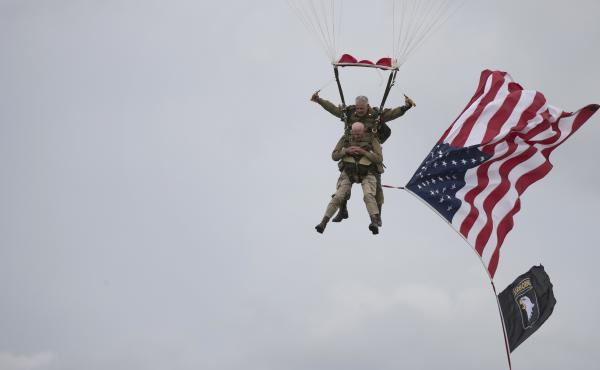 U.S. World War II D-Day veteran Tom Rice, from Coronado, Calif., parachutes in a tandem jump into a field in Carentan, Normandy, France, on Wednesday. Approximately 200 parachutists participated in the event, replicating a jump made by U.S. soldiers on Ju