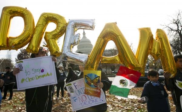 Demonstrators hold up balloons during an immigration rally in support of the Deferred Action for Childhood Arrivals  and Temporary Protected Status programs, near the U.S. Capitol on Wednesday.