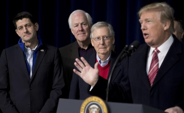 President Trump, with House Speaker Paul Ryan of Wisconsin, Senate Majority Whip John Cornyn og Texas, and Senate Majority Leader Mitch McConnell of Kentucky, speaks to reporters after a recent retreat where GOP leaders made plans for 2018.