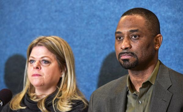 Diane Gross and Khalid Pitts, owners of the Cork Wine Bar, take part in a press conference announcing their unfair competition lawsuit against the Trump International Hotel in Washington, D.C., on Thursday.