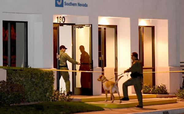 Las Vegas Metropolitan Police Department K-9 officers search the Jewish Community Center of Southern Nevada after an employee received a suspicious phone call that led about 10 people to evacuate the building on Feb. 27. Jewish institutions across the nat