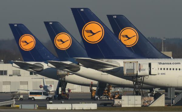 Lufthansa airplanes parked in front of an airport in Munich, Germany, in November 2016. Lufthansa is among the airlines that have announced they will resume boarding travelers affected by President Trump's executive order.